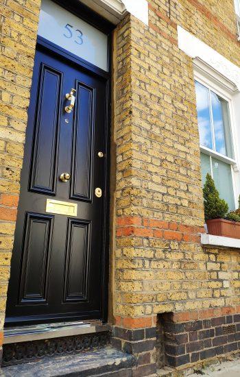 Black Security Doors with Brass Door Furniture